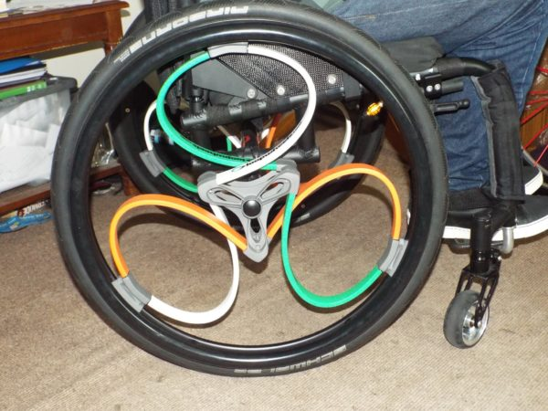 Orange, green & white loopwheels for wheelchairs